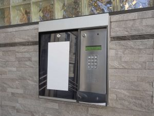 Intercom access to  apartment building at entrance to lobby