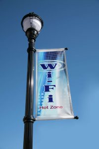 """sign on lampost announcing a wi-fi """"hot zone"""""""